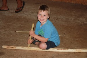 Making fire with hibiscus wood